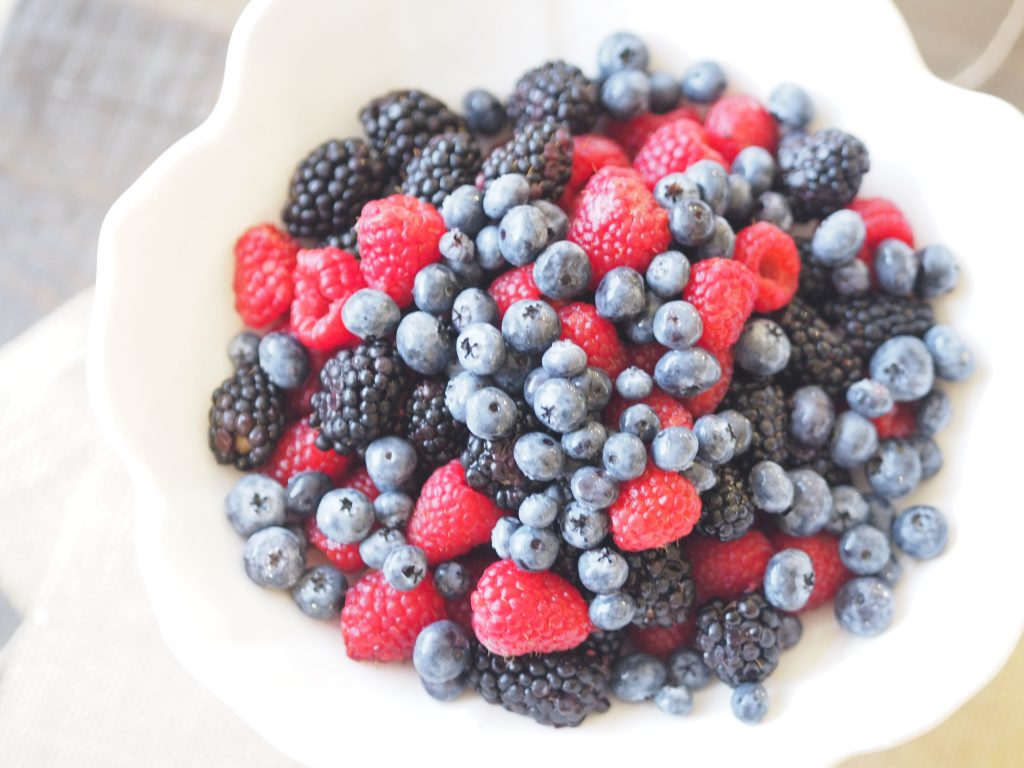 Blueberries, blackberries and raspberries mixed in a bowl