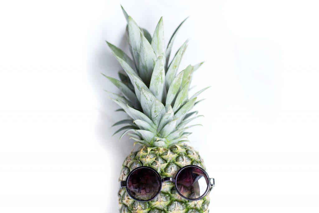 A pineapple wearing sunglasses