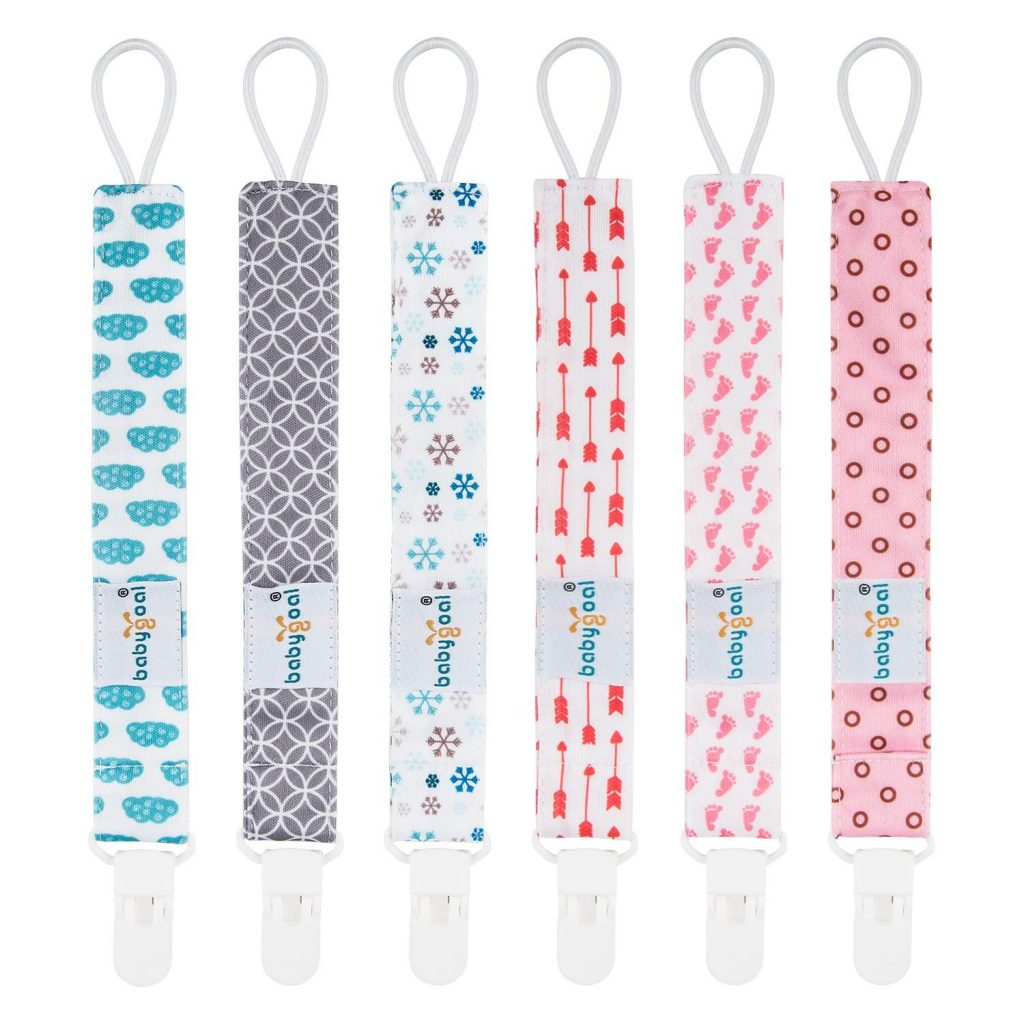 six pacifier clips in assorted colors and styles