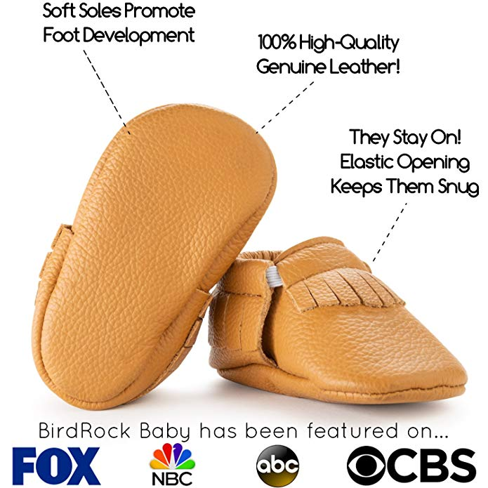 a pair of tan leather moccasins