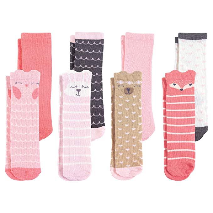 eight pairs of girl's knee high socks
