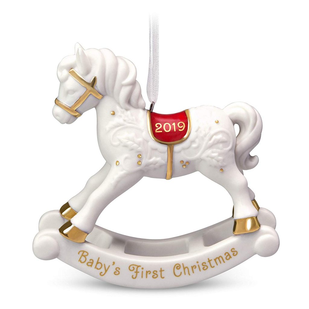 Keepsake ornament of a white horse with Baby's First Christmas 2019 written on the ornament for Christmas Traditions