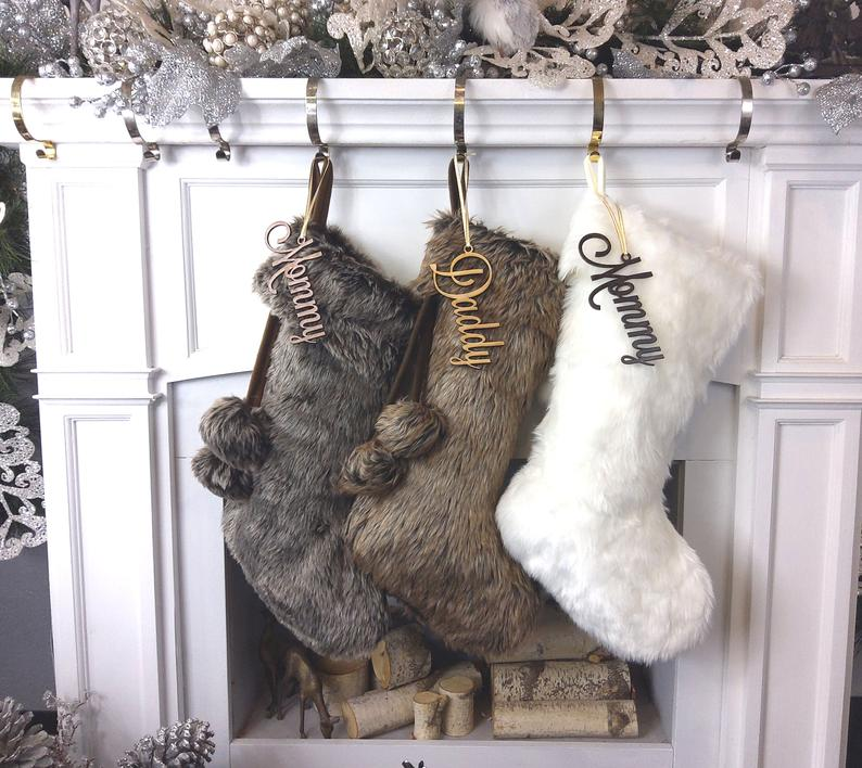 Three fur stockings hung on a mantle as a gift for Christmas Traditions