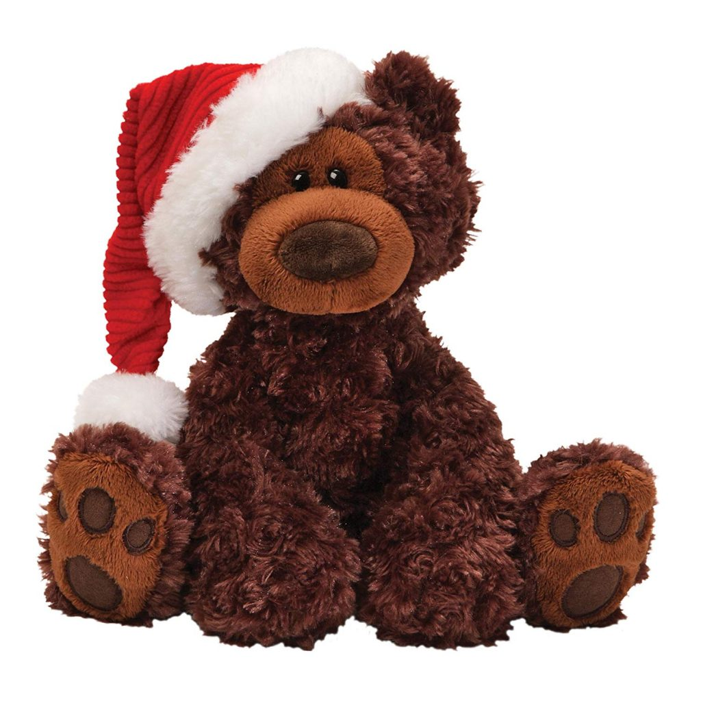 Brown teddy bear wearing a Santa hat